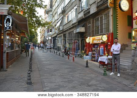 Istanbul, Turkey - September 18th 2019. A Restaurant Worker Waits For Customers On A Street In The R