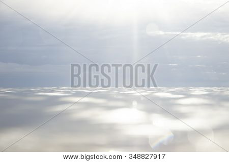 Water Sky And Sea Horizon With Dramatic Clouds And Sunflare