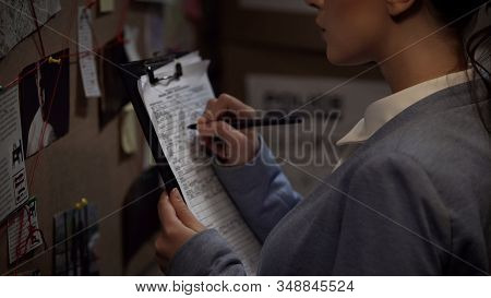 Criminal Investigator Drawing Up Record, Writing Down Case Details, Inquiry
