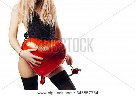 Sexy Young Woman In Erotic Black Lingerie With Red Heart Shape Balloon. Beautiful Nude Body Of Sensu