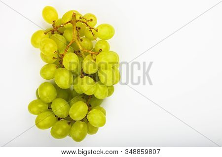 Large Green Juicy Grape On A White Background. Flat Lay. View From Above. Place For Writing. A Bunch
