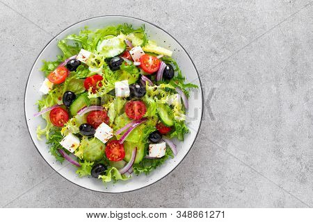 Salad With Fresh Raw Vegetables, Cucumber, Tomato, Olive, Onion, Lettuce And Feta Cheese, Greek Cuis