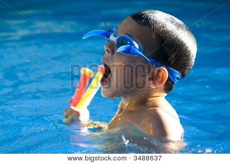 Little Boy In The Swimming Pool