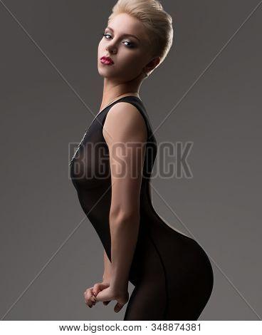 Sexy Blonde In Nylon Overalls In Profile In Studio