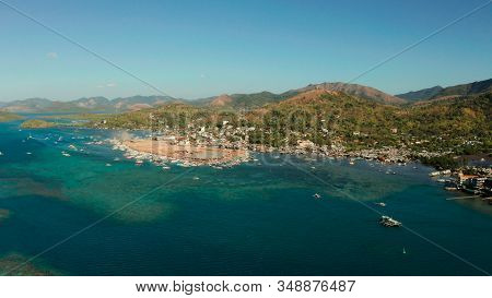Aerial View Coron City, Tourist Destination In The Philippines.pier And Promenade Coron Town With Bo