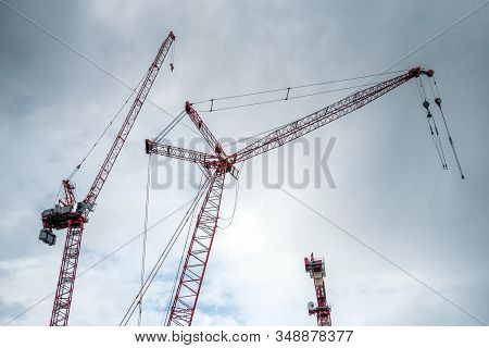 Cranes At A Construction Site On A Cloudy Day