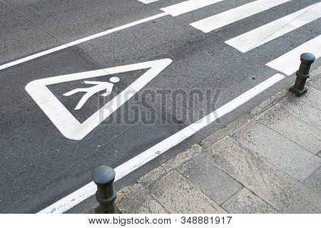 Pedestrian Sign Painted On The Asphalt Of A City Road. Zebra Crossing Concept