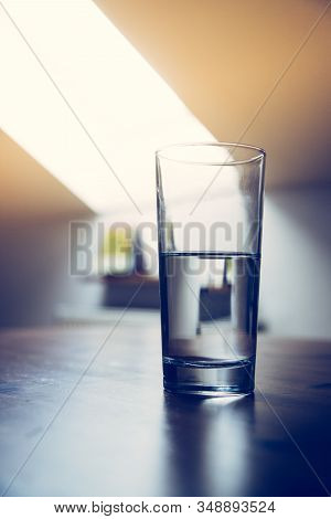 Clear Glass Of Refreshing, Cold Water On The Table