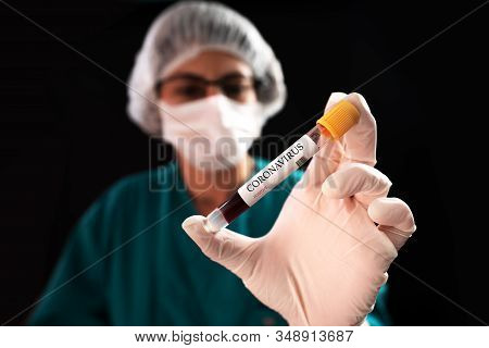 Blood Sample In A Flask For Analyzing Corona Virus And Producing Vaccine. Corona Virus Outbreaking
