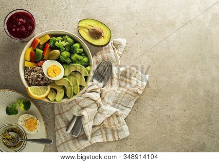 Healthy Salad Meal With Quinoa, Egg, Avocado  And Mixed Fresh Vegetables On Grey Background Top View