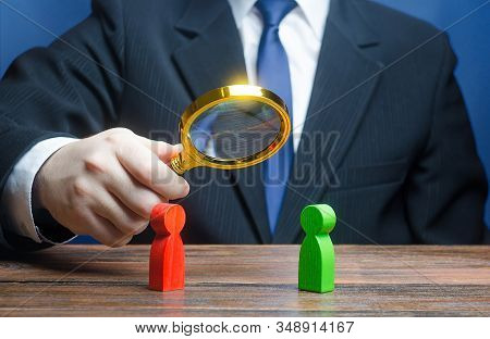 A Man Is Studying Confrontation Of Two Persons. Establishing Contact. Peaceful Resolution Disputes,