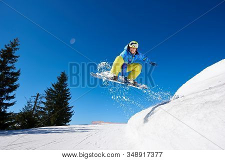 Male Snowboarder, Free Rider Flying On Snowboard, Jumping In Air Downhill On Copy Space Background O