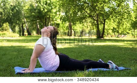 Fat Female Practicing Yoga In Park, Dreaming About Being Skinny, Asana