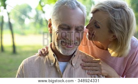 Caring Mature Wife Flirting With Handsome Husband In Park, Whispering Compliment