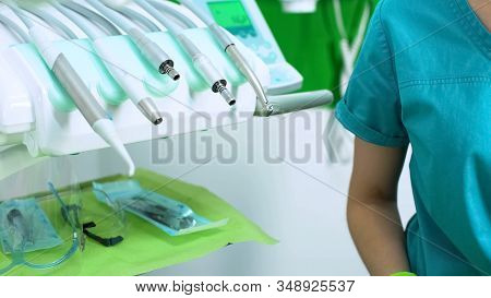 Stomatologist Sitting Near Modern Equipment In New Clinic, Best Patient Service