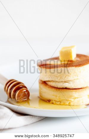 Fluffy Japan Souffle Pancakes, Hotcakes With Butter And Maple Syrup Or Honey Sauces On Light White B