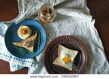 An Abundant Toast Breakfast With Pate, Cheese And Onion Marmalade On A Blue Plate, Decorated With Th