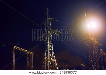 High Voltage Substation At Night. Soft Focus. The Concept Of Energy Consumption, Electricity Consump