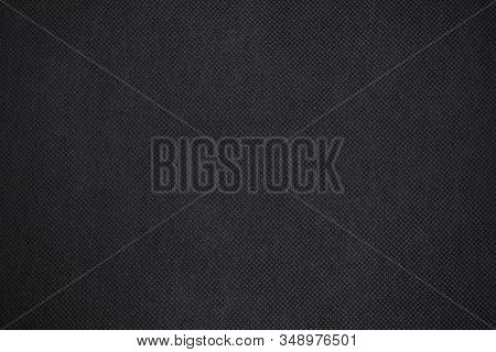 Abstract Black Fabric Texture Background Or Dark Grey Cloth Texture Background With Vignette Effect