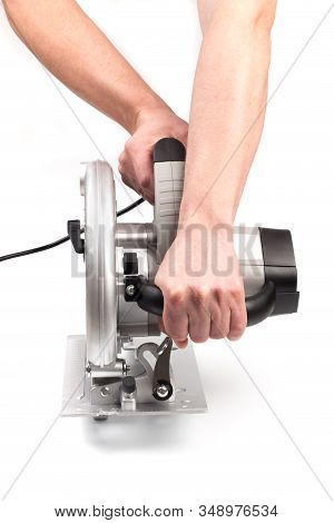Electric Circular Saw Holding By Mans Hands .circular Saw Is Designed For Cutting Wood And Plastic.