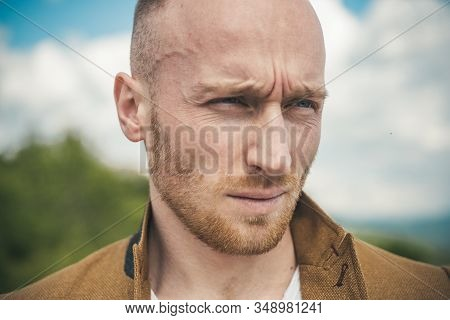 Handsome Man Ginger Bearded Guy Looking Brutal. Copy Space. Young Handsome Man In Jacket. Portrait O