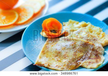 Crepe-suzette Pancakes In Orange-cream Sauce. The Concept Homemade Food