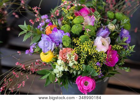Colorful Spring Bouquet From Fresh Cut Flowers - Freesia, Chrysanthemums, Persian Buttercups, Sea La