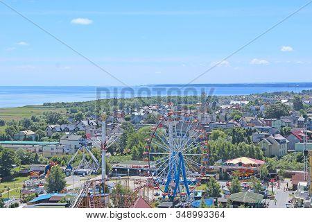 Wladyslawowo / Poland. 24 June 2019:  Ferris Wheel On Blue Sky Background. Panorama Of Wladyslawowo