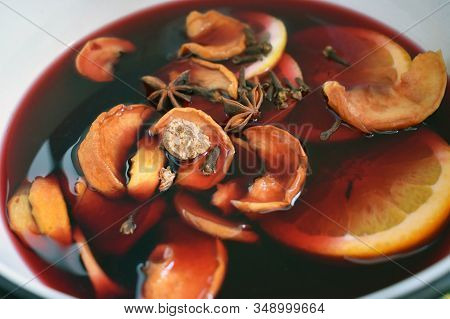 Mulled Wine Preparation. Preparation Of Mulled Wine At Home, Red Wine With Spices, Apple, Oranges, C