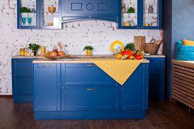 Modern Blue Kitchen Interior In Loft Style With Furniture. Stylish Scandinavian Cuisine In Decor. Wo