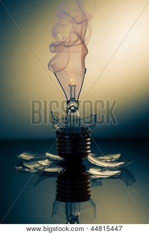Broken light bulb smoking