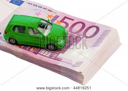 green model car on banknotes, symbolic photo for car buying, financing and costs poster