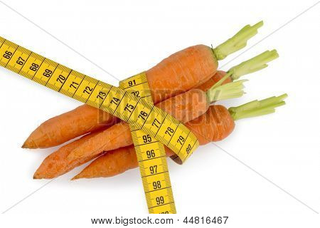 organically grown carrots with tape. fresh fruit and vegetables are always healthy. photo icon for healthy diet.
