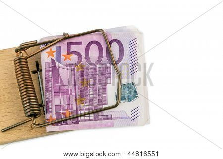 many euro bank notes in mousetrap. symbolic photo for debt and debt with credit.