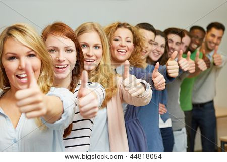 Many successful students holding thumbs up in a row