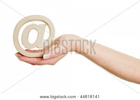 Hand holding an at sign as internet symbol