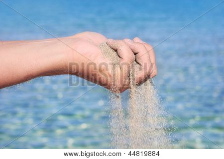 Sand Pour Away Through The Hands
