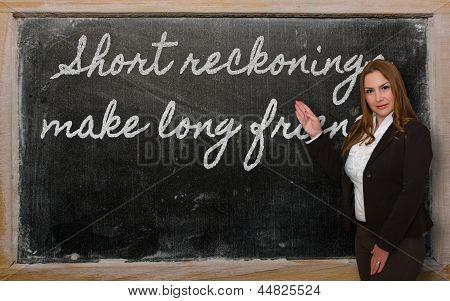 Teacher Showing Short Reckonings Make Long Friends On Blackboard