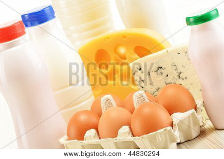 Composition with variety of dairy products isolated on white poster