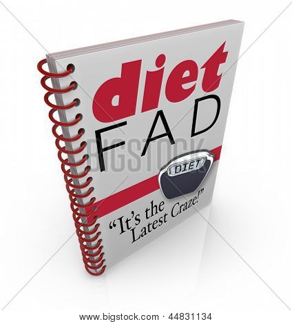 A spiral-bound book with the words Diet Fad - It's the Latest Craze to illustrate a new dieting sensation inside a best-selling manual or guide to help you lose weight