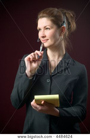 Beautiful Secretary Wearing Headset Taking Dictating Notes