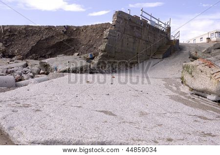 An image showing the effects of coastal erosion on the East Yorkshire coast showing the remains of a launching slip. This coast is said to have the worst erosion in Europe with properties and roads faal into the sea on a regular basis. poster