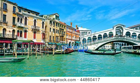 VENICE, ITALY - APRIL 11: A view of the Grand Canal and Rialto Bridge on April 14, 1013 in Venice, Italy. This main canal is 3800 meter long, 30-90 meters wide, with an average depth of five meters