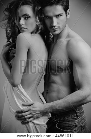 Fashion portrait of beautiful young lovers