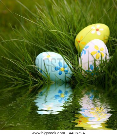 Painted Easter Eggs Reflecting In Water