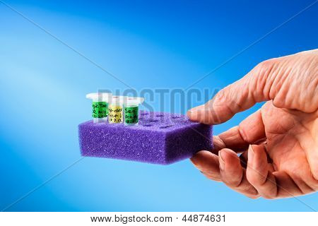 Microtube sample medical tray in hand