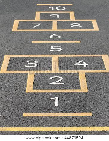 Hopscotch game painted on a school playground.