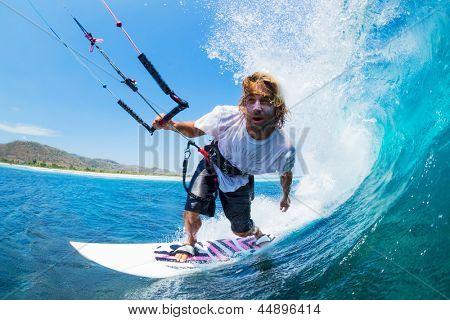 Extreme Sport, Kite Surfer Riding Wave getting Barreled