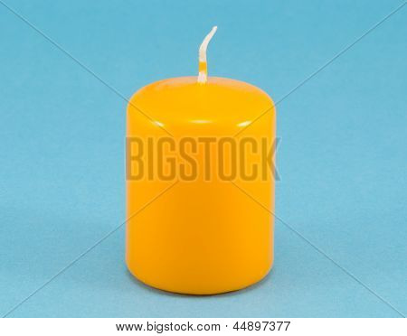 Yellow Thick Wax Candle Wick Blue Background