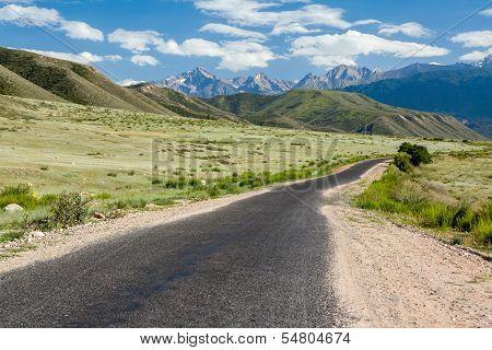 Asphalt road in Tien Shan mountains, Kirghizia poster